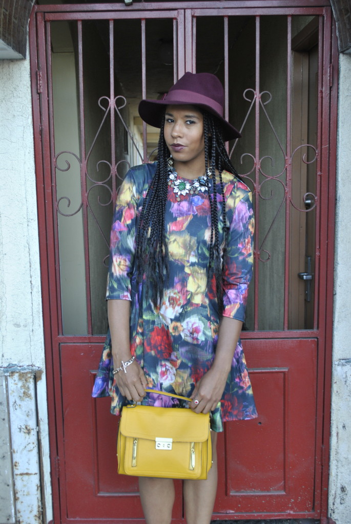 bold purse with printed dress
