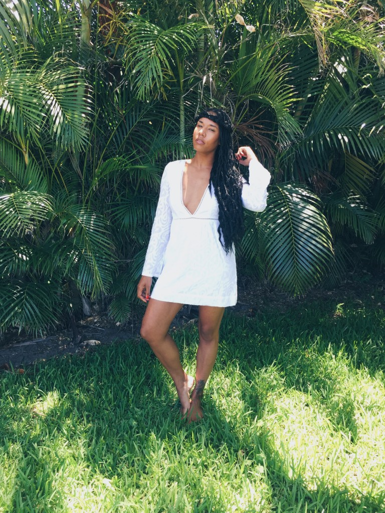 what to wear on tropical vacation. deep v white dress plunging neckline
