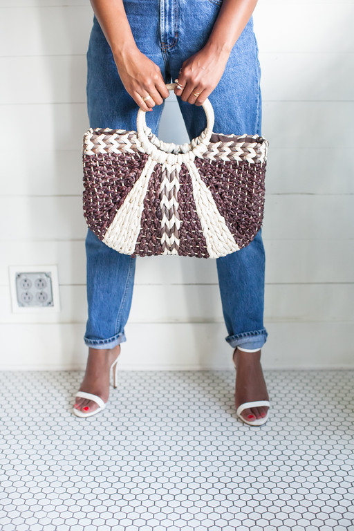 straw summer bag. mom jeans. white strappy heels