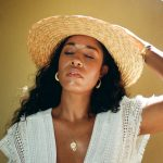 What to wear on a summer tropical vacation. Cute white outfit. How to wear straw hat. Ali & Jay. Black style travel LA NYC blogger