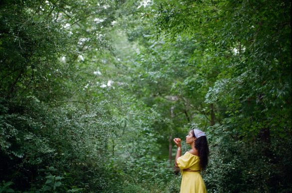 Black girl on film in forest with long hair fruit 35mm Alabama photography. How to get great skin better skincare for cheap free