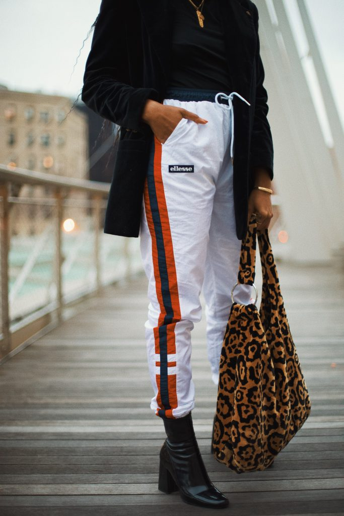 How to style track pants. Dress up athlesiure outfit with blazer ellesse USA. Brooklyn New York black girl fashion style blogger blog influencer