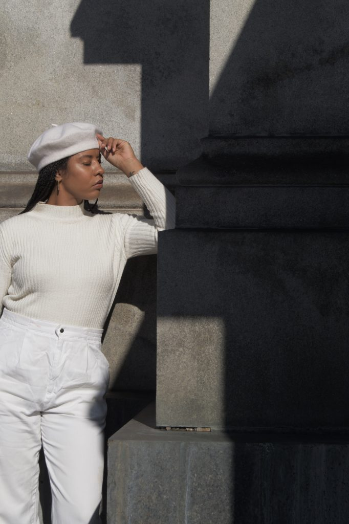 All white winter outfit. Black girl woman in all white street style blogger influencer New York Brooklyn wool beret with braids