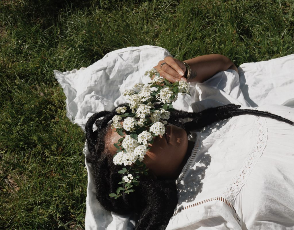 black girl with flowers in park ethereal floral photography vsco primark outfit blogger editorial nyc fashion style blog