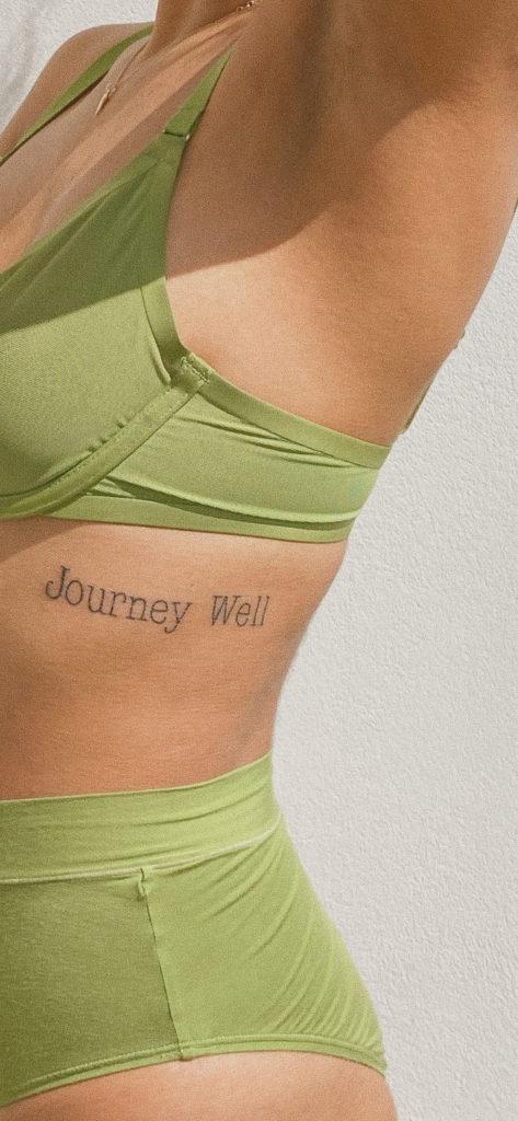 journey well ribcage tattoo. cuup green bra
